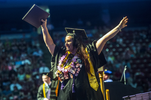 Chris Detrick  |  The Salt Lake Tribune Sheila Behunin celebrates after receiving her diploma during Westminster College's Commencement at the Maverik Center Saturday May 31, 2014. 977 students graduated.