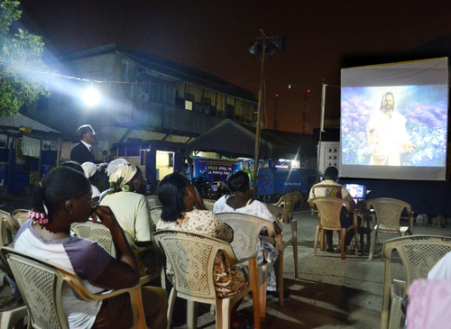 Mike Stack  |  special to The Salt Lake Tribune  Towns people watch video about Jesus Christ at Adventist crusade in Jamestown, Ghana.  03/04/2014