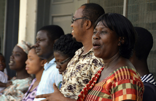 Mike Stack  |  special to The Salt Lake Tribune  Adventist Mary Antwi greets fellow members during the after meeting lineup in Cape Coast, Ghana.  03/09/2014