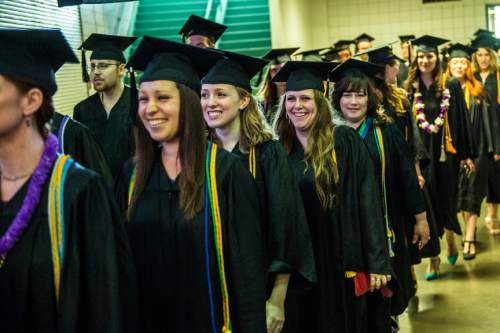 Chris Detrick  |  The Salt Lake Tribune Family members and friends take pictures of Westminster students as they walk into the Maverik Center before Westminster College's Commencement Saturday May 31, 2014. 977 students graduated.