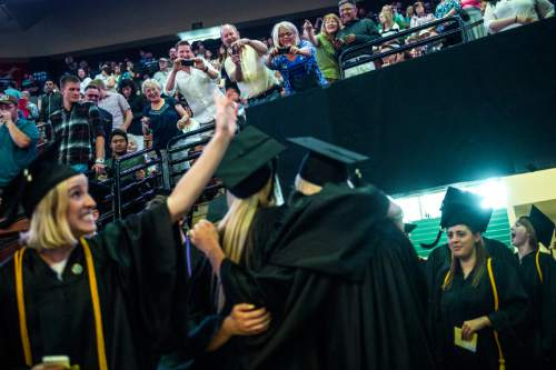 Chris Detrick  |  The Salt Lake Tribune Randall Coates Nigohosian kisses his mom Margo Coates Huddleston before Westminster Collegeís Commencement at the Maverik Center on Saturday. 977 students graduated. Nigohosian graduated with a bachelors in arts in special education and elementary education.