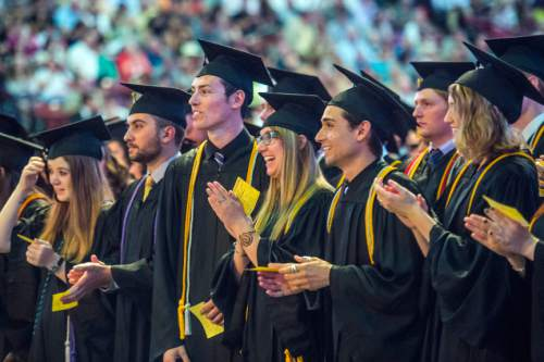 Chris Detrick  |  The Salt Lake Tribune Westminster students walk into the Maverik Center before Westminster College's Commencement Saturday May 31, 2014. 977 students graduated.