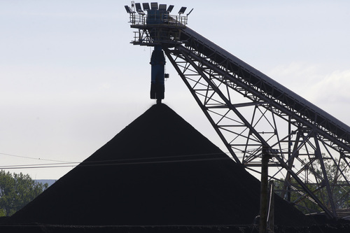 A hill of coal is seen at the North Omaha Station, a coal-burning power station, in Omaha, Neb., Monday, June 2, 2014. The Obama administration on Monday unveiled a plan to cut earth-warming pollution from power plants by 30 percent by 2030, setting in motion one of the most significant actions to address global warming in U.S. history. (AP Photo/Nati Harnik)
