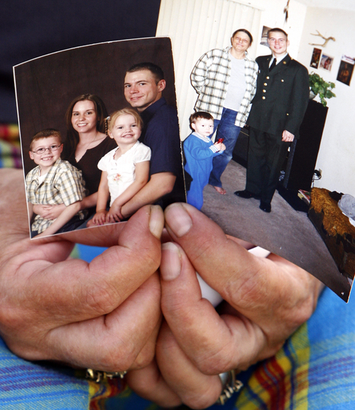 Above, Curtiss' mother Ruth Serrano clutches photos of her son and his family; at left, Army Staff Sgt. Kurt Curtiss, wife Elizabeth, son Joshua and daughter Cecilia, from September 2006. At right, a photo of Serrano and Army Staff Sgt. Kurt Curtiss. South Ogden native, Army Staff Sgt. Kurt Curtiss was on a recovery mission at a hospital with his unit when he was caught in crossfire and killed, said his sister, Lynn Burr. Curtiss has lived in both Utah and Arizona. He served two tours of duty in Iraq before being transferred to Fort Richardson in Alaska. He was deployed to Afghanistan last year, and had been home for a visit about a month ago. Photo by Leah Hogsten/ The Salt Lake Tribune S. Ogden 8/28/09
