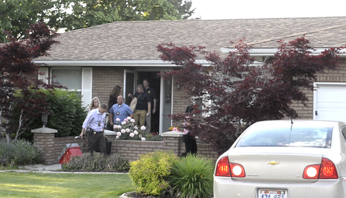 Rick Egan  |  The Salt Lake Tribune  FBI and state law enforcement agents leave John Swallow's residence in Sandy on Monday after searching the home for several hours. Monday, June 2, 2014