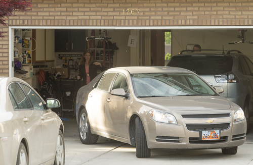 Rick Egan  |  The Salt Lake Tribune  FBI and local agents back a car into the garage of John Swallow's house during a search Monday, June 2, 2014