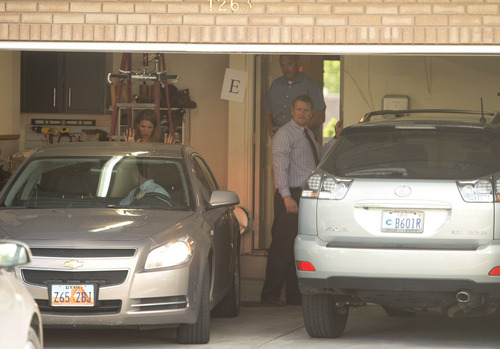 Rick Egan  |  The Salt Lake Tribune  FBI and local agents back a car into the garage of John Swallow's house during a search Monday June 2, 2014.