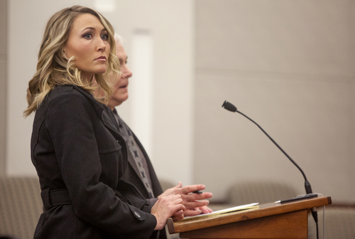 Davis High School English teacher Brianne Altice stands before the judge during her first court hearing in Farmington on Friday, Jan. 3, 2014. Altice was arrested in October and accused of having sex with a student. A preliminary hearing has been scheduled for Jan. 31. (BENJAMIN ZACK/Standard-Examiner Pool Photo)