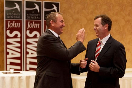 Trent Nelson  |  Tribune file photo  Utah Attorney General Mark Shurtleff, left, and Utah Attorney General candidate John Swallow share a laugh on the night Swallow secured the Republican nomination to run for the attorney general's office in 2012.
