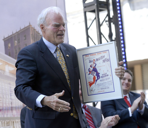 "Al Hartmann  |  The Salt Lake Tribune Local businessman and philanthropist Spencer Eccles accepts an orginal Broadway poster for ""The Music Man"" at the groundbreaking for the new George S. and Dolores Dore' Eccles Theater on Regent Street in Salt Lake Tuesday June 3.  The Eccles foundation donated $15 million for the theater."