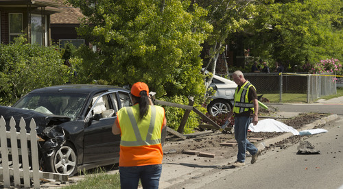 Steve Griffin  |  The Salt Lake Tribune   Unified Police authorities secure a fatal car crash on 700 east near 2900 south in Salt Lake City, Utah Tuesday, June 3, 2014.