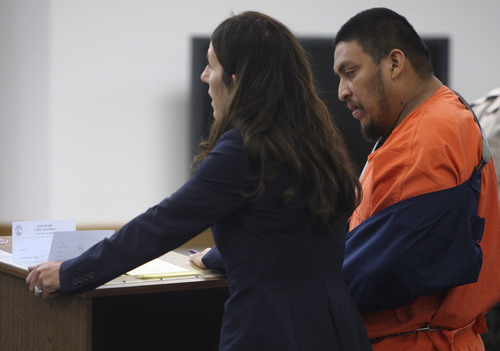 Elvis Quintanilla-Vasquez, right, stands with defense attorney Cara Tangaro during his initial court appearance Tuesday, June 3, 2014, in Moab's 7th District Court. Quintanilla-Vasquez is charged with four counts of aggravated human smuggling, three counts of human smuggling, one count of improper lane travel in connection with a May 16, 2014, crash on I-70 in Grand County that killed four people and injured four others.