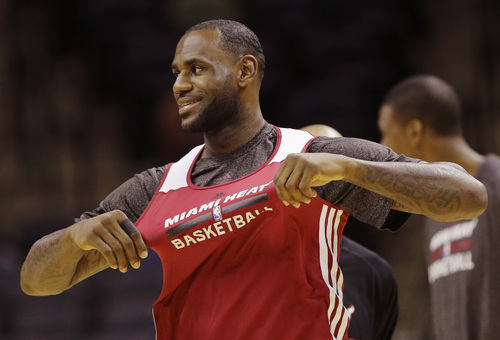 Miami Heat forward LeBron James warms up during basketball practice on Wednesday, June 4, 2014 in San Antonio. They play Game 1 of the NBA Finals against the San Antonio Spurs on Thursday. (AP Photo/Eric Gay)