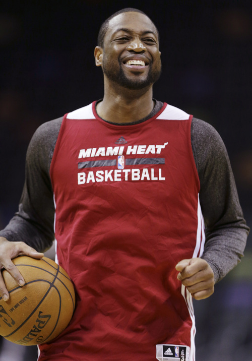 Miami Heat guard Dwyane Wade jokes around during basketball practice on Wednesday, June 4, 2014 in San Antonio. They play Game 1 of the NBA Finals against the San Antonio Spurs on Thursday. (AP Photo/Eric Gay)
