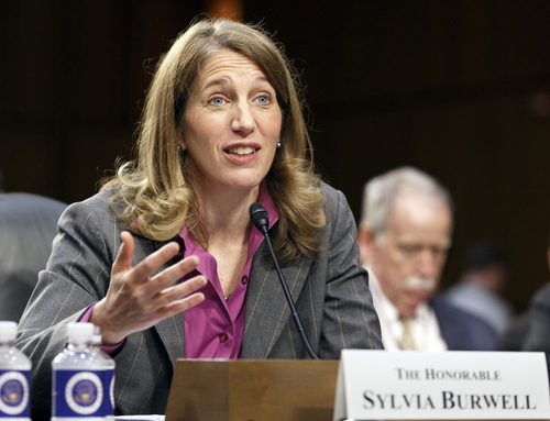 FILE - This May 14, 2014 file photo shows Sylvia Mathews Burwell, President Barack Obama's nominee to become secretary of Health and Human Services testifying on Capitol Hill in Washington. More than 2 million people who got health insurance under President Barack Obama's law have data discrepancies that could jeopardize coverage for some, a government document shows. On Wednesday, Burwell easily passed a key test vote in the Senate. (AP Photo/J. Scott Applewhite, File)