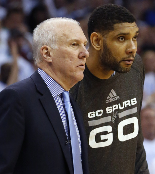 San Antonio Spurs coach Gregg Popovich, left, and Spurs' Tim Duncan watch during the second half against the Oklahoma City Thunder in Game 6 of the Western Conference finals NBA basketball playoff series in Oklahoma City, Saturday, May 31, 2014. (AP Photo/Sue Ogrocki)