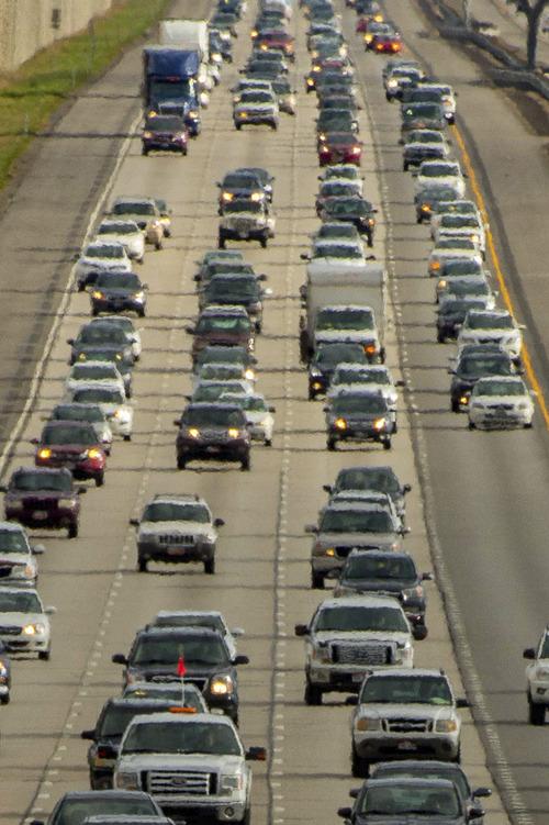 Trent Nelson  |  The Salt Lake Tribune Rush hour traffic northbound on I-15 in Farmington, Thursday, March 27, 2014.