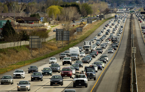 Trent Nelson  |  The Salt Lake Tribune Rush hour traffic northbound on I-15 in Farmington, Thursday, March 27, 2014.