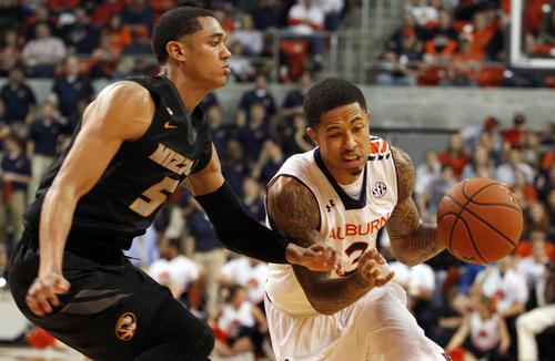Auburn's Chris Denson (3) takes the ball to the basket around Missouri's Jordan Clarkson (5) during the second half of an NCAA college basketball game on Saturday, Jan. 11, 2014, in Auburn, Ala. Missouri won 70-68. (AP Photo/Butch Dill)