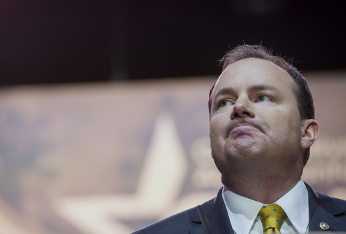 Sen. Mike Lee, R-Utah pauses while speaking at the Conservative Political Action Committee annual conference in National Harbor, Md., Thursday, March 6, 2014. Thursday marks the first day of the annual Conservative Political Action Conference, which brings together prospective presidential candidates, conservative opinion leaders and tea party activists from coast to coast.(AP Photo/Cliff Owen)