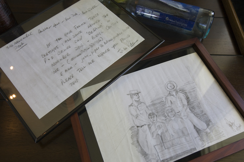 (Melissa Majchrzak  |  Special to the Tribune) A drawing and a message in a bottle that Clint Buffington found in the Caribbean islands over the course of several trips.