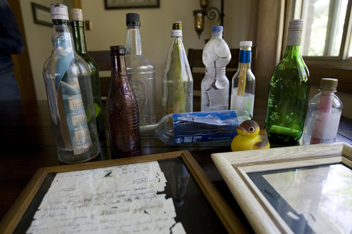 (Melissa Majchrzak  |  Special to the Tribune) Some of Clint Buffington collection of messages in a bottles that he has found in the Caribbean islands over the course of several trips.