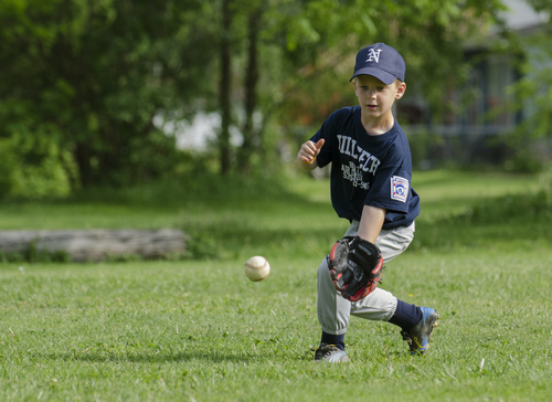 Owen Newcomer warms up before a Little League game in Williamsport, Pa. , May 28, 2014. Newcomer is the great grandson of Dick Hauser who played on one of the original Little League teams in 1939, making him a fourth generation Little Leaguer. (AP Photo/Ralph Wilson)