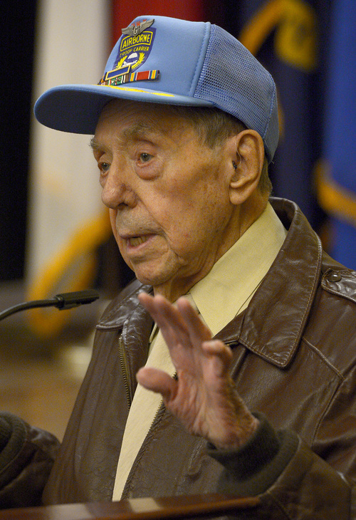 Leah Hogsten  |  The Salt Lake Tribune Jack Whipple to the crowd what it was like to fly a glider into France on D-Day during the ceremony Friday, June 6, 2014, while loaded with supplies and guns. On the 70th Anniversary of D-Day, Fort Douglas Military Museum commemorated the Normandy invasion with a color guard and a salute to the troops, sailors and pilots who helped liberate France.