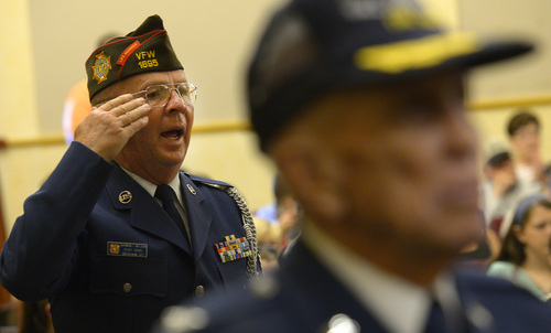 Leah Hogsten  |  The Salt Lake Tribune Air Force veteran and State of Utah Chaplain, Norman Nelson sings the Air Force fight song Friday, June 6, 2014 as all the armed servicemen at the ceremony are recognized and honored for their service to country.  On the 70th Anniversary of D-Day, Fort Douglas Military Museum commemorated the Normandy invasion with a color guard and a salute to the troops, sailors and pilots who helped liberate France.