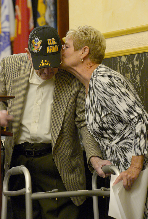 Leah Hogsten  |  The Salt Lake Tribune Pam Hutchinson kisses her father Albert Vise, an Army D-Day veteran who stormed Omaha Beach after he shared his story of the invasion on the French coast, Friday, June 6, 2014. On the 70th Anniversary of D-Day, Fort Douglas Military Museum commemorated the Normandy invasion with a color guard and a salute to the troops, sailors and pilots who helped liberate France.