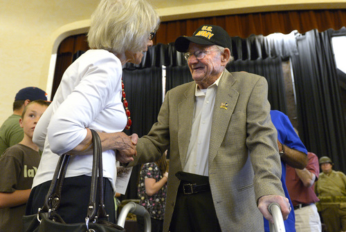 Leah Hogsten  |  The Salt Lake Tribune Angela Walz thanks Albert Vise, an Army D-Day veteran who stormed Omaha Beach for his service, Friday, June 6, 2014. On the 70th Anniversary of D-Day, Fort Douglas Military Museum commemorated the Normandy invasion with a color guard and a salute to the troops, sailors and pilots who helped liberate France.