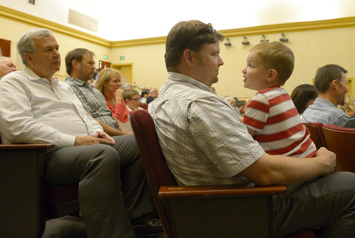 Leah Hogsten  |  The Salt Lake Tribune C. J. Kulp entertains his son Aiden, 3, as he and his family, including his father-in-law Stephen Hutchinson, left, listen to their family patriarch Albert Vise, an Army D-Day veteran who stormed Omaha Beach, shares his story of the invasion on the French coast, Friday, June 6, 2014. On the 70th Anniversary of D-Day, Fort Douglas Military Museum commemorated the Normandy invasion with a color guard and a salute to the troops, sailors and pilots who helped liberate France.