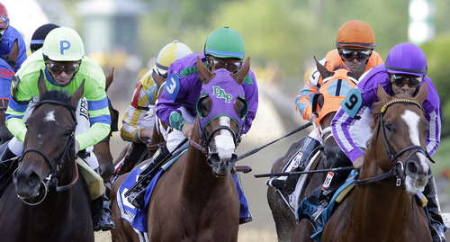 FILE - In this Saturday, May 17, 2014 file photo, California Chrome, center, ridden by Victor Espinoza, Pablo Del Monte, right, ridden by Jeffrey Sanchez, and Ria Antonia, left, ridden by Calvin Borel, race to the first turn during the 139th Preakness Stakes horse race at Pimlico Race Coursein Baltimore. California Chrome might abandon his Triple Crown bid if New York officials do not allow the colt to wear a nasal strip in the Belmont Stakes. (AP Photo/Patrick Semansky), File