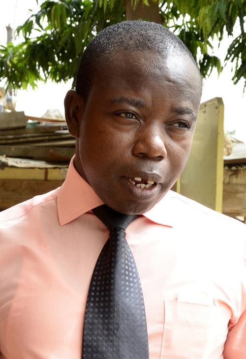 Mike Stack     special to The Salt Lake Tribune  Jehovah's Witness Elder Jehu Appiah talks outside a Kingdom Hall in Labadi, Ghana. 3/2/2014