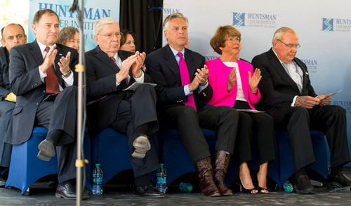 Trent Nelson  |  The Salt Lake Tribune Dignitaries applaud as the Huntsman Cancer Institute breaks ground on a new wing, the Primary Children's & Families Cancer Research Center, in Salt Lake City, Friday June 6, 2014. Left to right: Utah Governor Gary Herbert, LDS Church leader Elder M. Russel Ballard, Jon Huntsman, Jr, Karen Huntsman, Jon Huntsman, Sr.