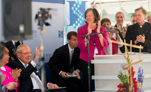 Trent Nelson  |  The Salt Lake Tribune Huntsman Cancer Institute Director Marcy Beckerle leads an ovation for Jon Huntsman, Sr, as the Institute breaks ground on a new wing, the Primary Children's & Families Cancer Research Center, in Salt Lake City, Friday June 6, 2014.