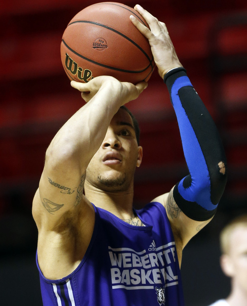 Weber State forward Davion Berry shoots during practice at the NCAA college basketball tournament Thursday, March 20, 2014, in San Diego. Weber State faces Arizona in a second-round game on Friday. (AP Photo/Lenny Ignelzi)