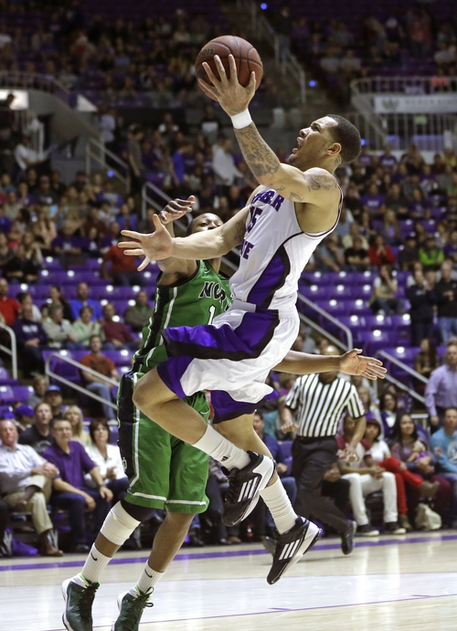Weber State's Davion Berry, right, goes to the basket as North Dakota' Jaron Nash (1) defends during the first half of an NCAA college basketball game in the championship of the Big Sky Conference tournament Saturday, March 15, 2014, in Ogden, Utah. Weber State won 88-67. (AP Photo/Rick Bowmer)