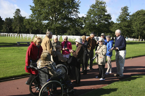 Daniel Nevot at a military cemetery near Normandy, telling his story to a group of fellow visitors.  Courtesy Patricia Nevot Johnson