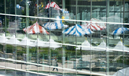 Steve Griffin  |  The Salt Lake Tribune  Tents are popping up on Washington Square for the 2014 Pride Festival talk in  Salt Lake City, Utah Friday, June 6, 2014. Here the colorful tents are reflected in the windows of the Main Library.