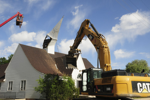 """Courtesy     Adus Dorsey   The LDS Teasdale church was torn down on Friday, to the disappointment of some locals. The building, called """"the Little White Chapel"""" by some, was completed in 1947 and hadnot been used in several years."""