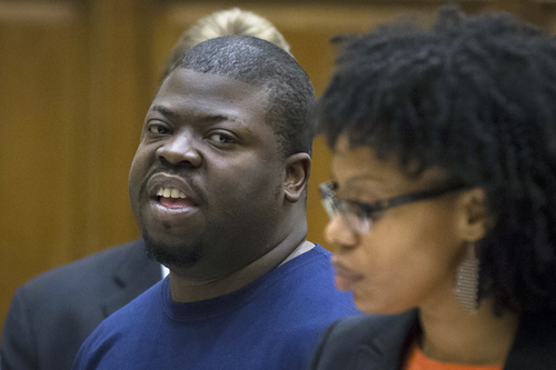 Daniel St. Hubert is arraigned at Brooklyn criminal court, Thursday, June 5, 2014, in New York. St. Hubert is the accused in a knife attack that left a 6-year-old boy dead and a 7-year-old girl critically injured in a public housing building that didn't have security cameras. (AP Photo/John Minchillo)
