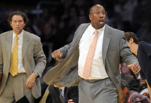Los Angeles Lakers head coach Mike Brown, right, gestures as assistant coach Quin Snyder looks on during the second half of their NBA basketball game against the Denver Nuggets, Saturday, Dec. 31, 2011, in Los Angeles. The Lakers won 92-89.  (AP Photo/Mark J. Terrill)