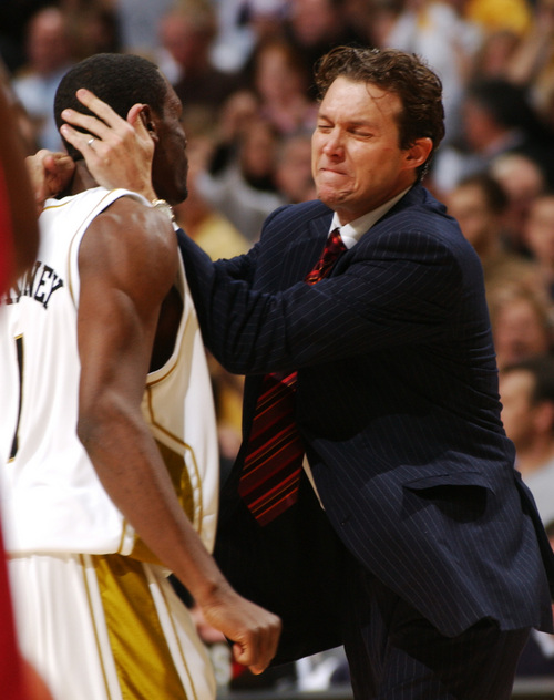 An emotional Missouri head coach Quin Snyder, right, rushes the court to hug player Jimmy McKinney, left, Saturday, Feb. 12, 2005, after McKinney stole the ball and scored late in their 68-65 overtime upset over Oklahoma in Columbia, Mo. (AP Photo/L.G. Patterson)