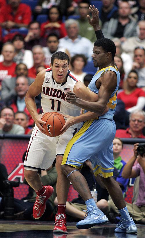 Arizona's Aaron Gordon (11) maneuvers for a shot against the defense of Southern University's Calvin Godfrey during the second half of an NCAA college basketball game Thursday, Dec. 19, 2013, in Tucson, Ariz. Arizona won 69-43. (AP Photo/John MIller)