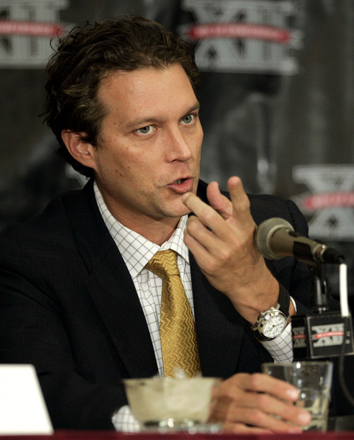 ** FILE ** Missouri basketball coach Quin Snyder gestures as he responds to a question during Big 12 media day, Oct. 19, 2005, in Irving, Texas. One day after saying he planned to finish the season, Snyder resigned Friday, Feb. 10, 2006, ending a seven-year stint that began with high hopes but ended in disappointment. (AP Photo/Tony Gutierrez)