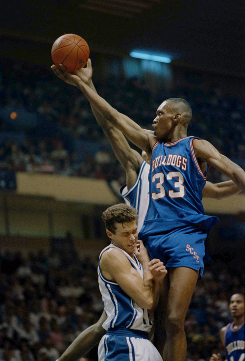 Duke's Quin Snyder is fouled by South Carolina State's Steven Mazyck (33) during the first round game of the NCAA East regional, Thursday, March 17, 1989 in Greensboro, N.C. Snyder was later removed from the game complaining of a migrain headache. Duke beat South Carolina State 90-69 and faces West Virginia in Saturday's second round. (AP Photo/Robert Willett)