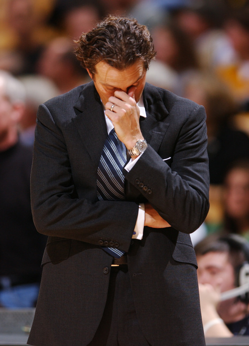 Missouri basketball coach Quin Snyder looks down Dec. 30, 2005, during the first half of a college game against Oakland in Columbia, Mo. Snyder resigned Friday, Feb. 10, 2006, ending a seven-year stint at Missouri. (AP Photo/L.G. Patterson)
