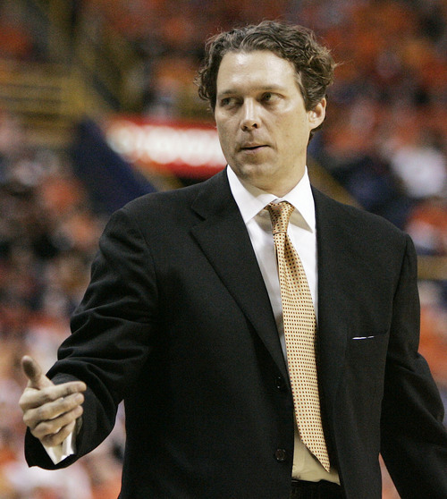 Missouri's head basketball coach Quin Snyder signals to his bench during the second half against Illinois during their college basketball game in St. Louis Wednesday, Dec. 21, 2005. Illinois defeated Missouri 82-50. (AP Photo/James A. Finley)