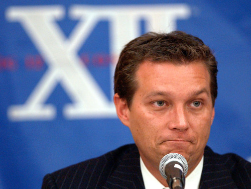 Missouri men's basketball coach Quin Snyder responds to questions regarding the NCAA investigation the program is facing during a conference, Thursday Oct. 30, 2003, during Big 12 media day in Dallas. (AP Photo/Tony Gutierrez)